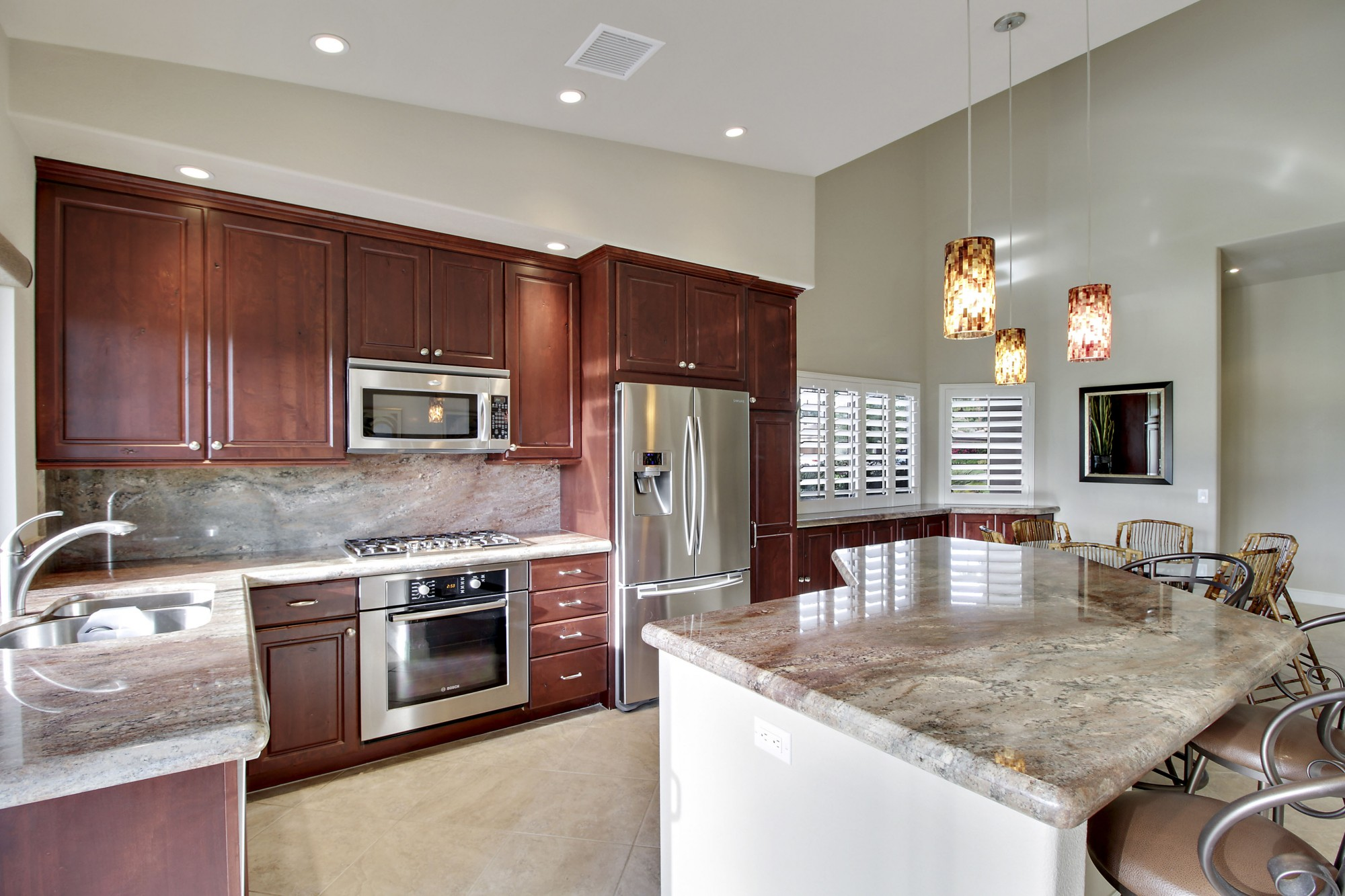 Remodeled kitchen with stainless steel appliances and granite countertops